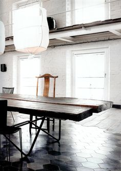 An industrial white home - Designed by Paola Navone in Spello,Italy . Featured on the Italian Elle Decor.