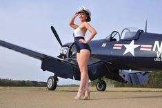 Tech Discover style Navy pin-up girl posing with a vintage Corsair aircraft - PinUp Girls Pin Up Girls Military Pins Air Festival Airplane Art Pin Up Photography Airplane Photography Pin Up Models Us Air Force Nose Art Pin Up Girls, Pin Up Girl Vintage, Vintage Pins, Air Festival, Pin Up Models, Us Air Force, Nose Art, Aviation Art, 1940s Fashion