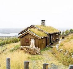 Photo by Espen Grønli via Domaine If there's any place worth giving up running water and electricity for, it might just be this one-room cottage on a 200-year-old Norwegian farm....