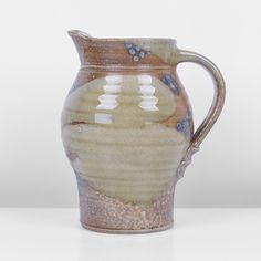 JANE HAMLYN, Stoneware, brown salt-glaze with green ash splashes and blue dotted designs, impressed JH seal