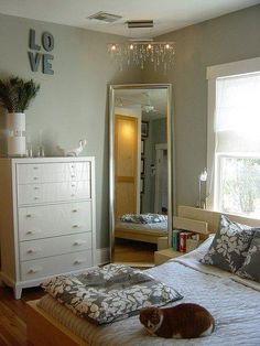 Large Mirror In Corner Of Bedroom With Chandelier Above It. I Love This  Dresser!