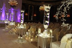 Tall glass vases with orchids overflowing. #white #wedding #flowers #decoration