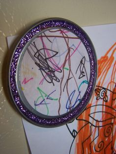 Turn child's artwork and a juice can lid into a magnet.