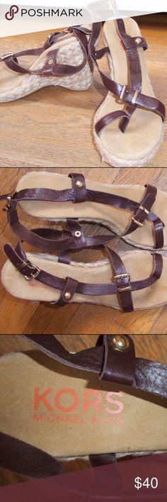 KORS Michael Kors Sandal Wedges Michael Kors espadrille wedges with brown leather straps and gold detailing. Lightly worn. KORS Michael Kors Shoes Wedges
