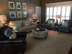 Geometric rug, blue chairs, ikat throw pillows, green geometric throw pillows, Parisian photography, linen sofa and ottoman