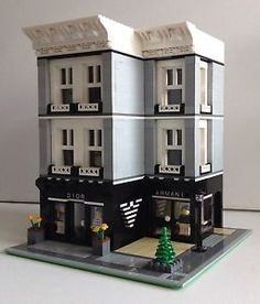 This LEGO building actually looks cool. Designer shops with a townhouse or two on top looks quite inquisitive.