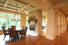 See through fireplace between dining room and family room.
