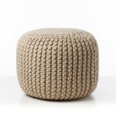 Hand knitted cotton ottoman in a beautiful Linen colour for a contemporary d?cor. Perfect for a relaxed setting area or for chilling out on the weekends.
