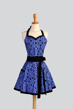 Womens Flirty Sweetheart Apron , Handmade Ruffled Sweetheart Neckline in Royal Blue and Black Floral. $37.00, via Etsy.