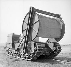 Churchill AVRE carpet layer vehicle with bobbin, of UK 79th (Experimental) Armored Division Royal Engineers, circa Mar-Apr 1944
