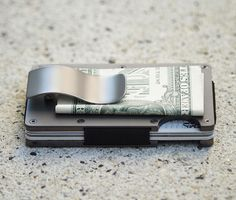 Slim RFID-blocking wallet made from Aluminum, Titanium, or Carbon Fiber.