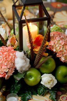 Centerpiece decoration: lantern - cotton - hydrangea - granny smith - roses - fern - pheasant feathers
