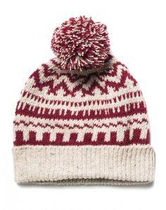 Gorro confeccionado en una cálida mezcla de lana jacquard, con vuelta de canalé en el bajo y pompón aplicado.
