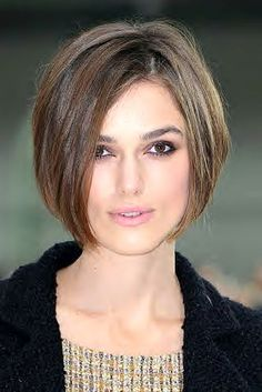 Kiera Knightly debuts her A-line 1920's bob sitting in the front row at Chanel;) Cool Chick!