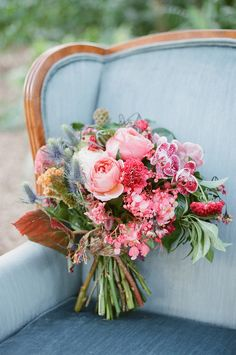 Beautiful pink bouquet on a vintage blue velvet chair. Bouquet by Anthology Co., vintage rentals from The Salvage Snob, image by Gianny Campos Photography. Pink Fall Weddings, Fall Wedding Bouquets, Fall Wedding Flowers, Spring Bouquet, Wedding Flower Arrangements, Bridesmaid Bouquet, Floral Wedding, Floral Arrangements, Blue Bouquet