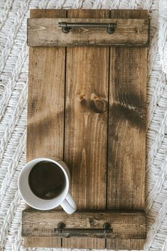 Modern Rustic Wood Tray with Metal Handles This modern rustic serving tray is made by hand with real wood and accented with metal handles for easy carrying. A beautiful piece to sit atop your bed, ottoman, couch, or even as a centerpiece for your table. Modern Rustic Bedrooms, Rustic Serving Trays, Types Of Furniture, Furniture Stores, Furniture Online, Furniture Outlet, Furniture Makeover, Wood Tray, Pallet Tray