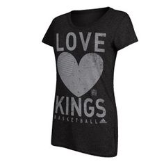 Sacramento Kings Ladies Her Love T-Shirt from Adidas is a cotton/polyester (50/50) blend with a vintage distressed front graphic with a sequin heart. Junior cut, long t-shirt.