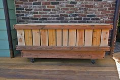 """Raised Planter Box with wheels 