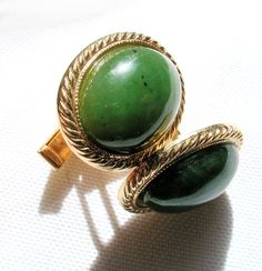 Here is a beautiful pair of vintage 1960s moss green agate cuff links. They are oval dark green stone cabochons with a few small flecks of brown,