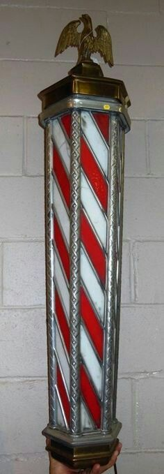 Lighted octagonal red & white leaded glass barber pole topped with brass eagle.