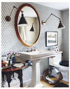 Just because it's a bathroom doesn't mean it can't feel dramatic. Add one or two oversize pieces, like a light fixture or a mirror, to create an expansive effect without overwhelming the room. Feeling a little confined? Bring in a side table. Bathroom furniture tends to be narrow, but a table the same depth as your sink will blend in perfectly, and you'll be bale to keep extra cotton balls and toiletries within arm's reach.