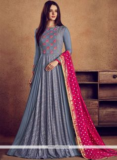 Enchanting sea blue wedding gown suit online which is crafted from rayon fabric with exclusive embroidery work. This stunning designer gown suit comes with semi cotton bottom, semi cotton inner and nylon silk dupatta. Indian Dresses Online, Indian Gowns Dresses, Pakistani Dresses, Indian Designer Outfits, Designer Gowns, Indian Outfits, Designer Anarkali Dresses, Long Gown Dress, Lehnga Dress