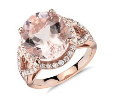 This gemstone ring features an oval morganite surrounded by brilliant diamonds and complemented in 18k rose gold.