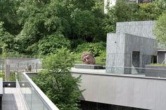 Asia Society in Hong Kong: Joseph Lau & Josephine Lau Roof Garden: Follow the sound of the Noble Water Feature up the exterior staircase to the stunning Joseph Lau Roof Garden. Standing beside Zhang Huan's Long Island Buddha,  you can enjoy the contrasting scenes of lush green foilage and the urban jungle of Admiralty. This open space allows the perfect setting for outdoor events and a leisurely stroll in the afternoon.