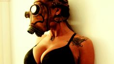 a busty steampunk woman wearing a push up bra and a gasmask looking at the camera. She has a tattoo of a rose on her left arm Steampunk Mask, Steampunk Cosplay, Gas Mask Girl, Shoulder Tats, Nuclear War, Apocalyptic Fashion, About Time Movie, Girl Photos, Women Wear