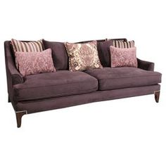 "Showcasing a sleek silhouette and nailhead-accented taper legs, this stylish sofa offers loose back pillows for a cozy and eclectic touch.   Product: SofaConstruction Material: Wood and fabricColor: PurpleFeatures:  Nailhead trimPillows includedDimensions: 38"" H x 87"" W x 41"" D"