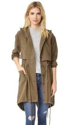 A military-inspired AG jacket with a slouchy hood and a drawstring fishtail hem. Button placket. Patch front pockets.