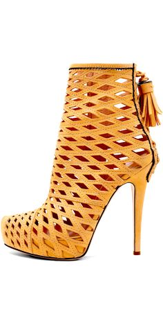 Gold leather open-weave pattern high-heeled ankle boots. I am lovin the tassel.