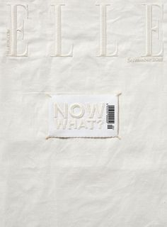 "_Elle_ has released a fully embroidered cover for its September issue as part of the magazine's redesign. Created by Claire Barrett, founder of London-based embroidery company ""Hawthorne & Heaney"":http://www.londonhandembroidery.com/, the magazine cover is a minimal ivory-white fabric with stitched logo. The artwork is simply a sewn-on patch, similar to a clothing label, stating ""Now what?"" in embroidered capitalised type alongside the bar code."