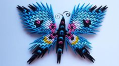 This butterfly was made using modular origami techniques. Over 250 small triangles were made and assembled.  Has a magnet on back side.  The size is about