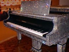 Liberace's rhinestone encrusted piano.....I could use this...and a house fabulous enough to contain it! LOL