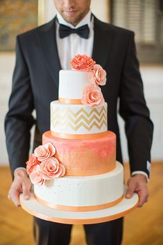 Beautiful coral and peach watercolor wedding cake with a chevron design and flower accents. #weddingcake #chevron #mwri