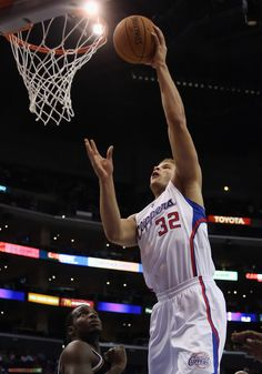 Blake Griffin #32 of the Los Angeles Clippers drives to the basket over Paul Millsap #24 of the Utah Jazz, October 17, 2012