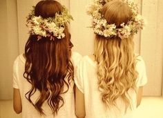 Best friends brown and blond curly hair with flowers for a crown
