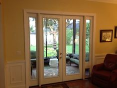 French Door with Sidelites and Pet Door.   This was a sliding glass door unit. Homeowners wanted french doors and needed a pet door.
