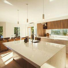 SOOTHING NEUTRALS // we simply love this light filled #kitchen by @thekitchen_designcentre featuring the popular Statuario Quartz on the #benchtops.  #wkquantumquartz #kitchendesign #islandbench #stone #neutrals #timber #light #homedecor #interiordesign #modern #design