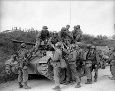 Division tank crewmen at Sukchon, North Korea, during the Korean War ... Many troops are on a M-24 Chaffey light tank.