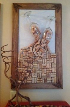 Home-made cork board made with collected corks and old frame and used some nice big wine glasses to have corks spilling out of them, love it! It's art and a functional cork board at the same time :) by Brenda Burdier
