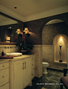 Give your bathroom an instant makeover. Simply install a Lutron dimmer.  www.automation-design.com