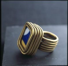 Ring | Alexander Calder.  1930. Gift for fellow artist Joan Miro. Brass wire and ceramic.  It's not a spiral, probably, but I love AC's jewelry and this is the best place I have to save it.