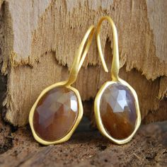 Autumn Hue September Sapphire Birthstone Gold Earrings - This beautiful organic sterling silver 18 carat gold plated oval hook earrings feature iridescent slices of unique precious Sapphire, with a rich golden autumn hue. #Embersjewellery #Jewellery #Special #Stones