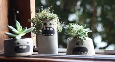 These concrete monster planters are so awesome
