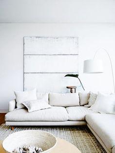 graphic white and black oversized artwork in white living room / sfgirlbybay