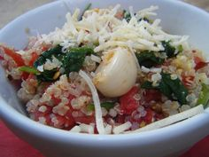 Quinoa with roasted garlic, tomatoes and spinach.... im planning on adding some fresh basil as well...