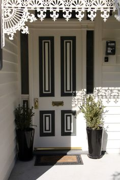black and white front door _ set it off with red flowers in a pot...perfection.