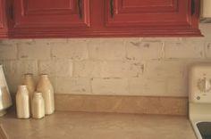The Twice Remembered Cottage - Thin brick pavers used as backsplash. Kitchen Remodel, Kitchen Reno, Kitchen Backsplash, Kitchen Ideas, Amish House, Creepy Houses, Thin Brick, Country Kitchen Farmhouse, Brick Pavers